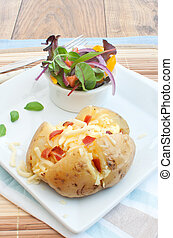 Jacket potato - Melting cheese and bacon pieces with baked...