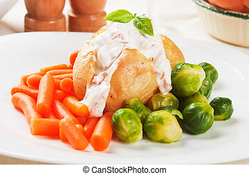 Jacket potato with cream sauce, baby carrot and brussel...