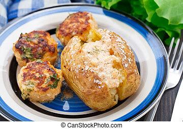 Jacket potato with meatballs on a plate