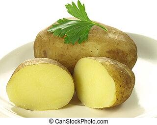 Jacket potatoes - Closeup of two jacket potatoes on isolated...