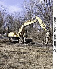 Jackhammer on Crane - Jackhammer on a yellow crane
