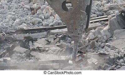 Jackhammer destroys concrete