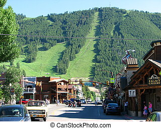 JACKSON HOLE, WYOMING - JUN 29: View of the main street with people walking and vegetation on background, June 29, 2007 in Jackson Hole - Wyoming.