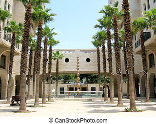 Palm trees and sculpture on Yerushalayim Avenue in Jaffa, Israel