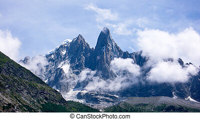 jagged mountain peak landscape with clouds