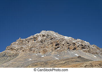 Jagged mountain with snow