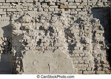 Jagged White Brick Wall - Jagged white painted brick wall as...