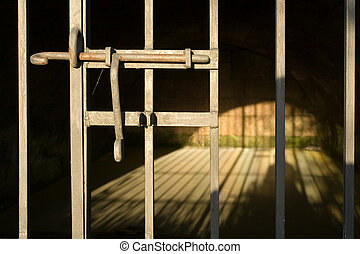 Jail cell - Old empty prison cell illuminated by sun