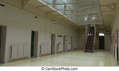 Jail with white paintings - A medium shot of a jail with...