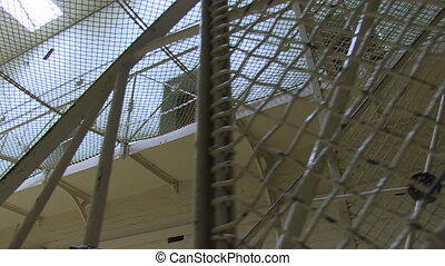 Jail with white paintings - A worms eye view shot of a jail....