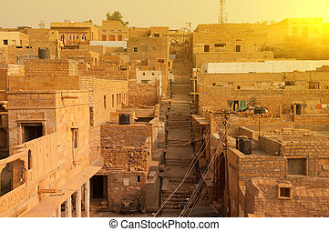 Jaisalmer city view, ancient brick houses in the sunset.