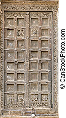 Jaisalmer, India. Old crooked wooden door. Usual entrance to the town house
