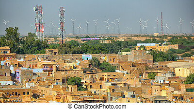 Jaisalmer, India. Streets with cell towers and wind power generators
