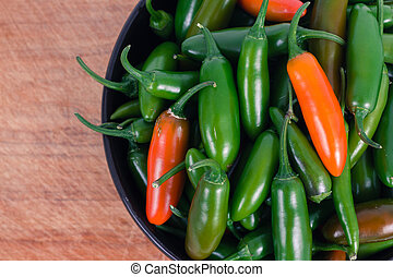 jalapeno and serrano pepper isolated over white