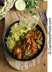 Jalfrezi Indian chicken curry with pilau rice and pappadoms