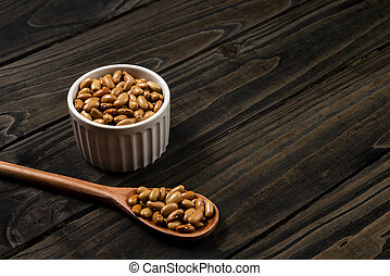 Jalo beans in pot. Wooden black background