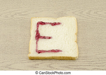 jam alphabet on sliced bread