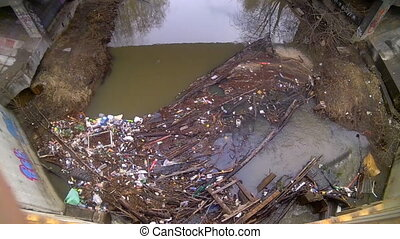 jam from garbage on the river in the city - lot of garbage ...