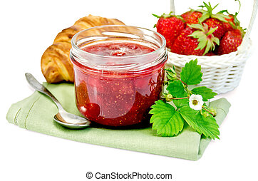 Jam of strawberry with a croissant