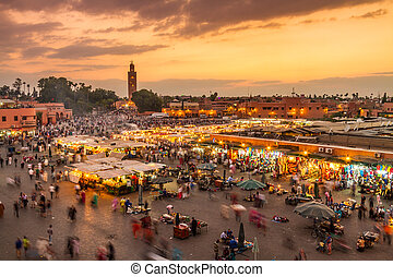 Jamaa el Fna market square in sunset, Marrakesh, Morocco,...