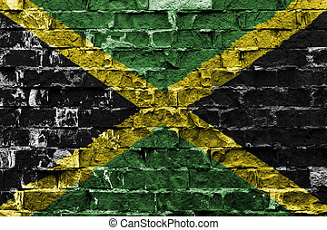 Jamaica flag on brick wall