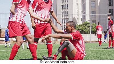 jambe prosthétique, équipe foot, joueur