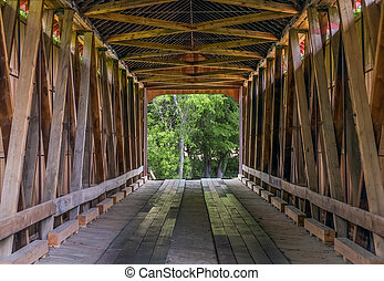 James Covered Bridge Interior - The wooden trusses of the...