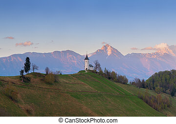 Jamnik church on a hillside at sunset in Slovenia, Europe