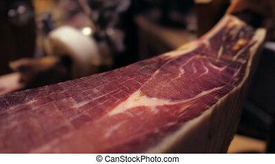 Jamon serrano. Pork leg ham jamon on stand - Jamon...