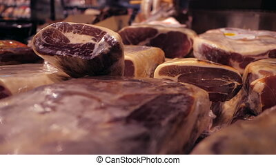 Jamon serrano. Traditional Spanish ham in the market close...
