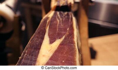 Jamon serrano.Traditional Spanish ham in the market close...