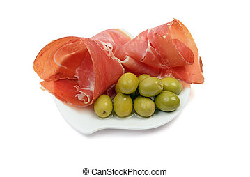Jamon with green marinated olives isolated