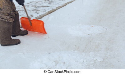 Janitor cleaning the yard of snow