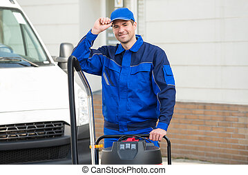 Janitor Wearing Cap While Standing On Street