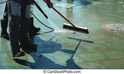 Janitor work, cleaning of streets. Cleaning city streets...