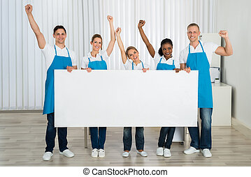 Janitors Cheering While Holding Billboard