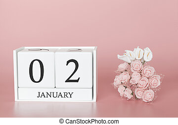 January 02nd. Day 2 of month. Calendar cube on modern pink background, concept of bussines and an importent event.