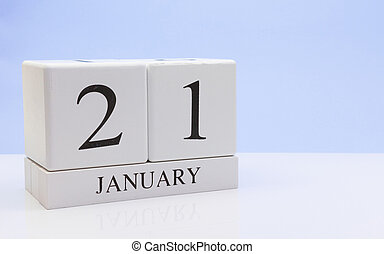 January 21st. Day 21 of month, daily calendar on white table with reflection, with light blue background. Winter time, empty space for text