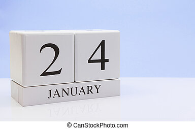 January 24st. Day 24 of month, daily calendar on white table with reflection, with light blue background. Winter time, empty space for text