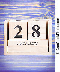 January 28th. Date of 28 January on wooden cube calendar