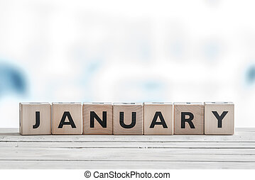 January sign on wooden cubes