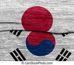 japan and south korea flag on wood