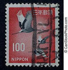 JAPAN - CIRCA 1961: A stamp, shows a fly Eurasian Crane (Grus grus lilfordi), printed in Japan circa 1961.