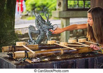 Japan .Nagoya. August , 2018.Hands of people during ritual ...