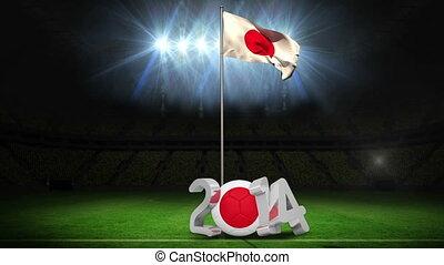 Japan national flag waving on football pitch on black...
