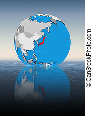 Japan on globe in water