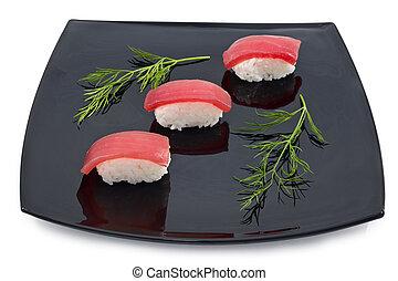 sushi in black plate