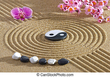 Japan zen garden with yin and yang