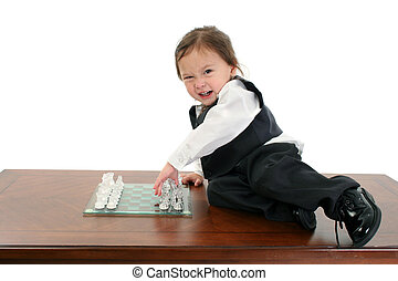 Adorable Japanese American three year old girl in business suit playing chess.
