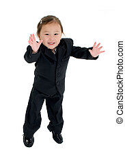 Adorable Japanese American three year old girl in business suit.